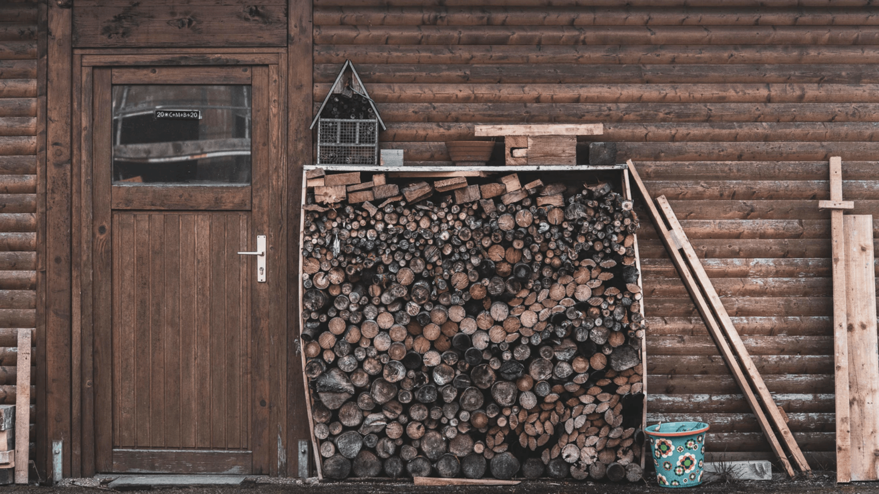 wood logs in front of cabin